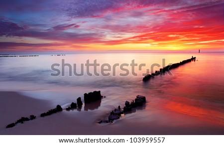 Baltic sea at beautiful sunrise in Poland beach. - stock photo