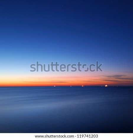 baltic sea bay with ship at the horizon - stock photo