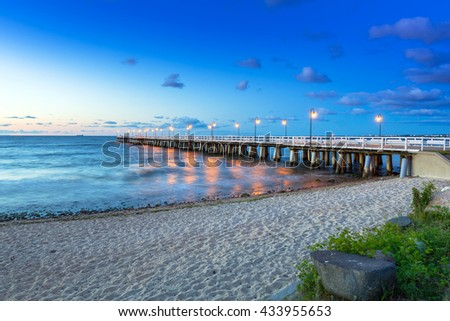 Baltic sea with pier in Gdynia Orlowo at sunrise, Poland - stock photo