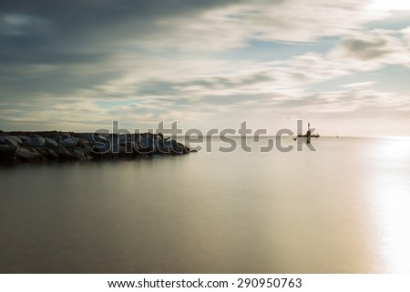 Baltic shore. Beautiful dramatic weather seascape of polish shore of Baltic sea and mouth of Vistula river in Gdansk.   - stock photo
