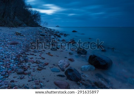 Baltic shore near Gdynia. Beautiful dramatic weather seascape of polish shore of Baltic sea photographed at night. - stock photo