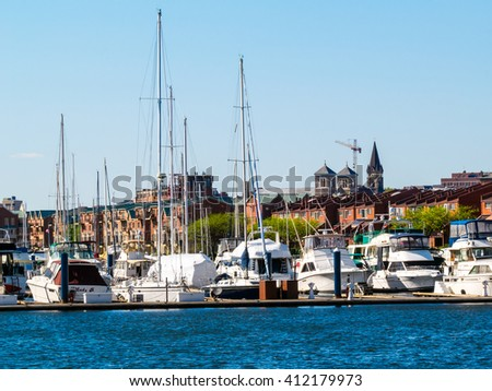 BALTIMORE-APRIL 23 - A view of sailboats in this marina with a city view off in the distance on April 23 2016 in Baltimore Maryland. - stock photo