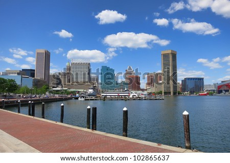Baltimore Maryland inner Harbor scenic area and downtown skyline cityscape with excursion boats in port - stock photo