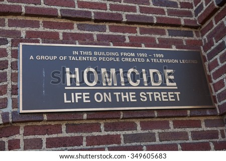 Baltimore, MD, USA - July 26, 2011: A sign on the Recreation Pier at Fells Point in Baltimore commemorates the building had been featured as police headquarters on  Homicide: Life on the Street. - stock photo