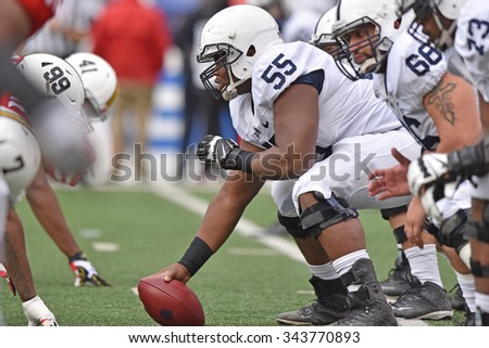 BALTIMORE - OCTOBER 24: Penn State Nittany Lions center Wendy Laurent (55) lines up over the ball during the NCAA football game October 24, 2015 in Baltimore.  - stock photo