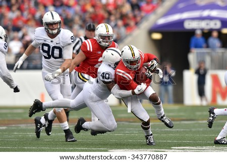 BALTIMORE - OCTOBER 24: Penn State Nittany Lions linebacker Jason Cabinda (40) makes a tackle on a rushing play during the NCAA football game against Maryland October 24, 2015 in Baltimore.  - stock photo