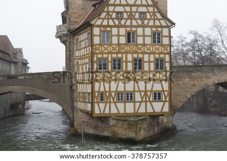 BAMBERG/GERMANY - 29 DECEMBER 2015 Rathaus. Trellis walls, windows, two stone bridges, river. - stock photo