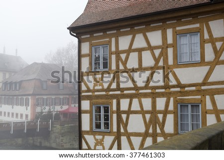 BAMBERG/GERMANY - 29 DECEMBER 2015: wall and windows of the Rathaus in a foggy day, - stock photo