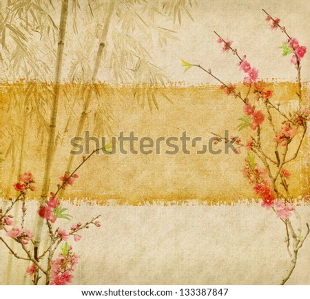 bamboo and plum blossom on old antique paper texture - stock photo