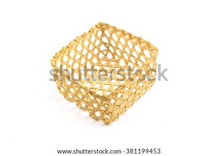 Bamboo basket on isolated background - stock photo
