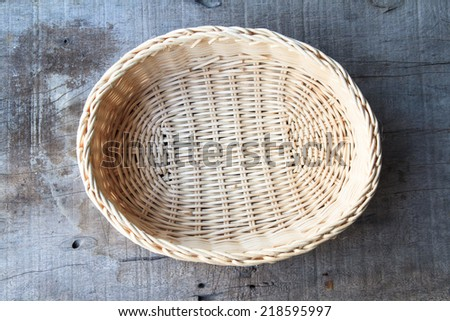 bamboo basket on the wooden table - stock photo