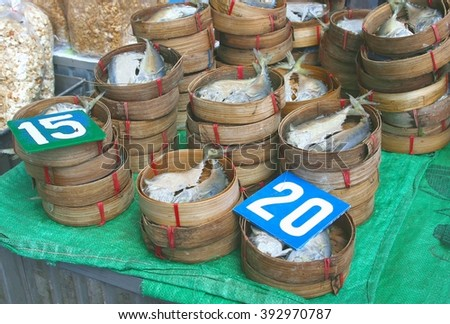 Bamboo baskets with fresh fish at the marketplace, Laos - stock photo