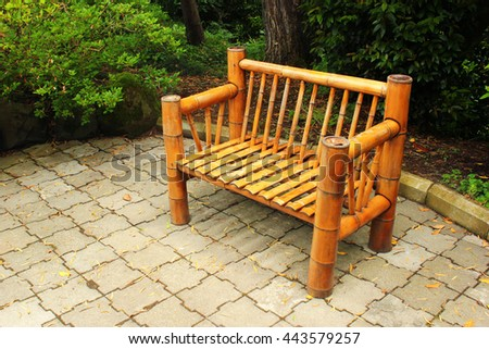 Bamboo bench in the garden - stock photo