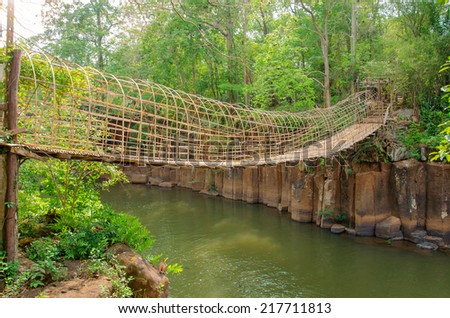 bamboo bridge over the river in Tad Pha Souam Waterfall at Paksa South Laos. - stock photo