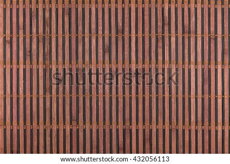 Bamboo brown mat as abstract texture, background, composition, view from above - stock photo