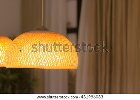 Bamboo ceiling light in living room, soft focus - stock photo