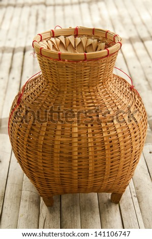 bamboo creel with bamboo background - stock photo