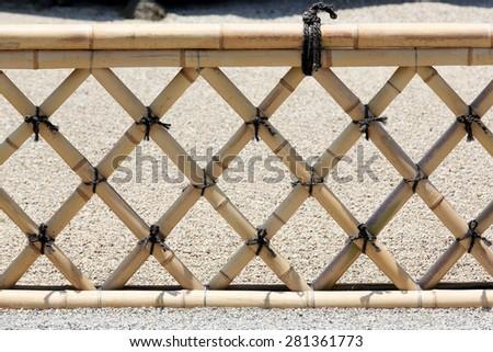 Bamboo fence in a Japanese garden - stock photo
