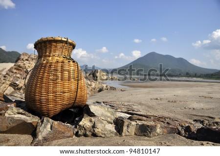 Bamboo Fish Sand River Basket Creel - stock photo