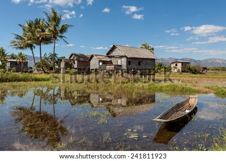 Bamboo houses on Inle lake in Myanmar - stock photo