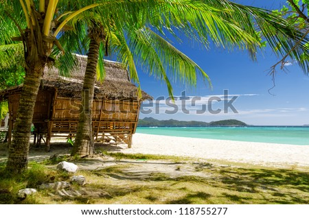 Bamboo hut on a tropical beach. - stock photo