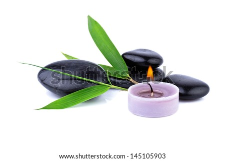 bamboo leaf and zen pebbles, candle over white, spa  concept - stock photo