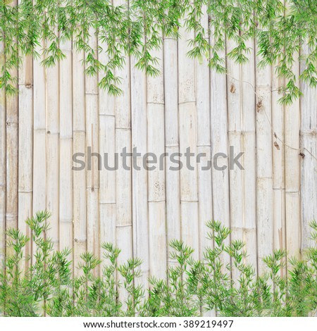 Bamboo leaves frame  on bamboo background - stock photo