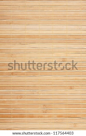 Bamboo mat background. The  mat from yellow bamboo - stock photo