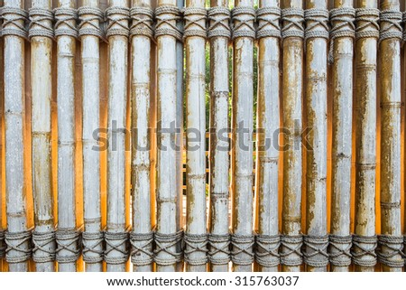 Bamboo panel with a rope tied - stock photo