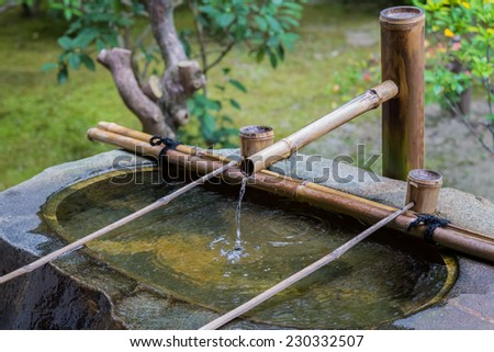 Bamboo Pipe with water dippers at Kennin-ji Temple in Kyoto - stock photo