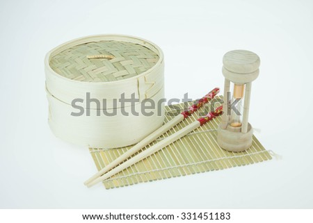 Bamboo round container shape  and clocks. Concept of death with time and success - stock photo