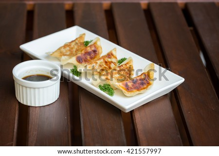 Bamboo tray with gyoza dumplings and dip sauce, view from above.,dumpling - stock photo