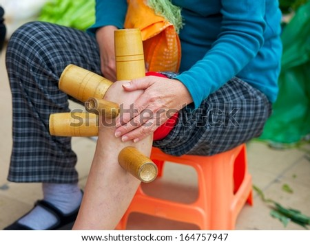 bamboo tube burn traditional street Chinese medicine - stock photo