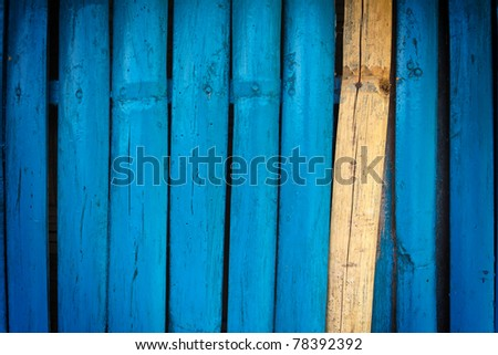 Bamboo wall painted blue - stock photo