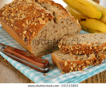 Banana bread on a brown table - stock photo
