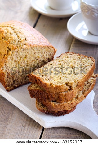 Banana bread, sliced on board - stock photo