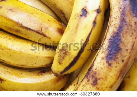 banana bunch on the turn in a market stall - stock photo