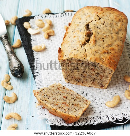 Banana cake with peanuts on rustic wooden table - stock photo