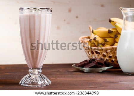 banana chocolate cocktail behind bananas and chocolate milk - stock photo