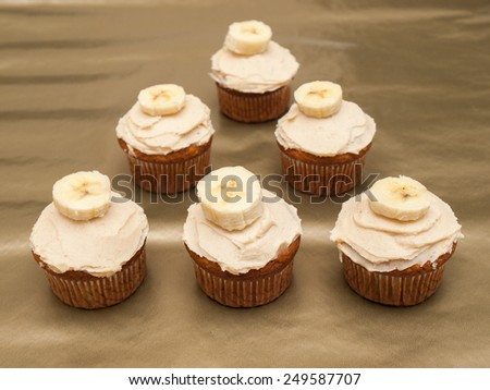 Banana cupcake with buttercream frosting - stock photo