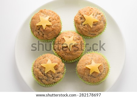 Banana cupcake with cheese on a white background - stock photo