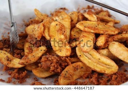 banana fried,delicious snacks bananas fried in hot oil.  - stock photo