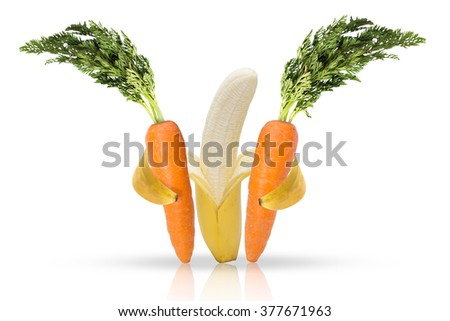 Banana fruit hugging carrots for love of health and a balanced diet - stock photo