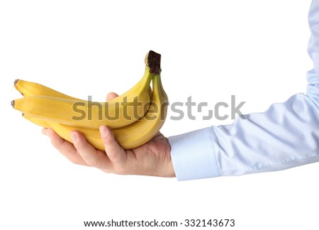 Banana in hand. Isolation on a white background. - stock photo