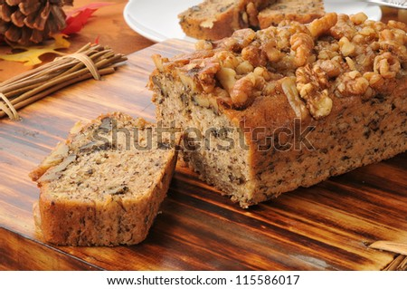 Banana nut bread with walnuts on a festive holiday table - stock photo