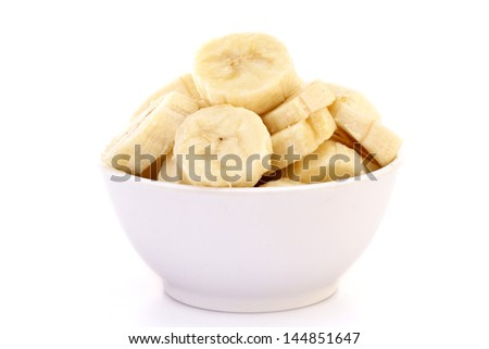 Banana slices in white bowl - stock photo