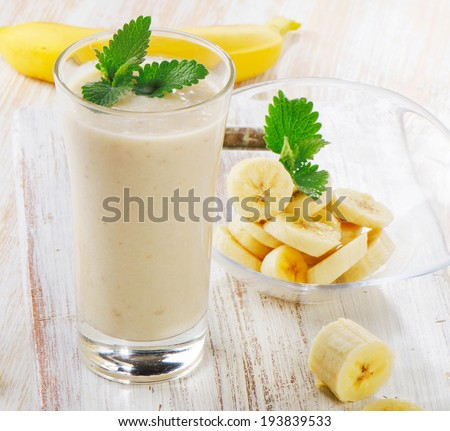 Banana Smoothie on a wooden table. Selective focus - stock photo
