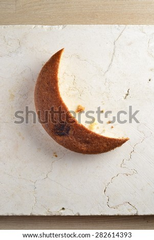 Banana sponge cake cut like moon shape. Ramadan special food. An idea. - stock photo