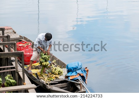 Bananas delivered by boat to the banana market in Mekong Delta, Vietnam - stock photo
