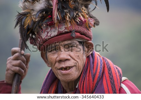 BANAUE, PHILIPPINES - JANUARY 24, 2014 : Unknown old ifugao man in national dress next to rice terraces. Ifugao - the people in the Philippines. Refers to the mountain peoples. - stock photo